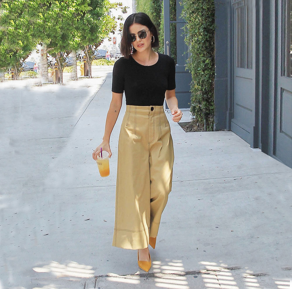 3ccef9f51b9 Actress Lucy Hale keeps it cool during the summer with a pair of wide leg  crop pants. This easy